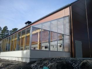 Växthus mot byggnad